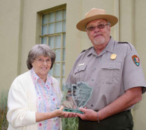 Sharon and a National Park Service Ranger holding the award
